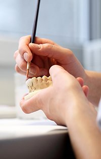 Dental lab work creating a diagnostic wax-up model
