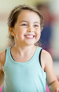 Little girl with healthy beautiful smile