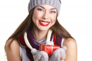 smiling happy woman holiday present