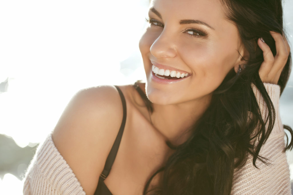 Woman smiling in the summer sun