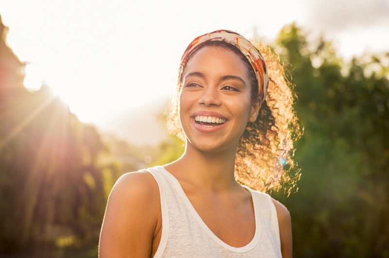 Woman smiling while walking outside